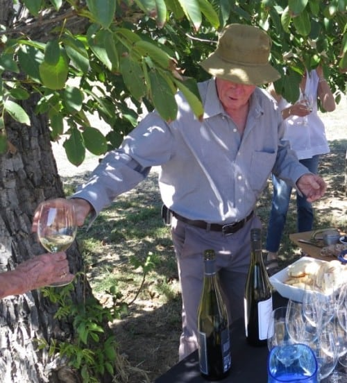 Firmly in the shade - Viv Thomson dispenses Riesling on a most welcome vineyard tour pit stop